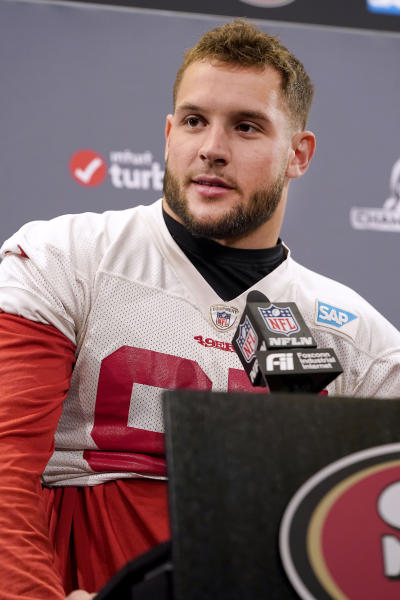 San Francisco 49ers defensive end Nick Bosa talks to reporters before their NFL football practice in Santa Clara, Calif., Wednesday, Jan. 15, 2020. The 49ers will host the Green Bay Packers for the NFC Championship on Sunday. (AP Photo/Tony Avelar)