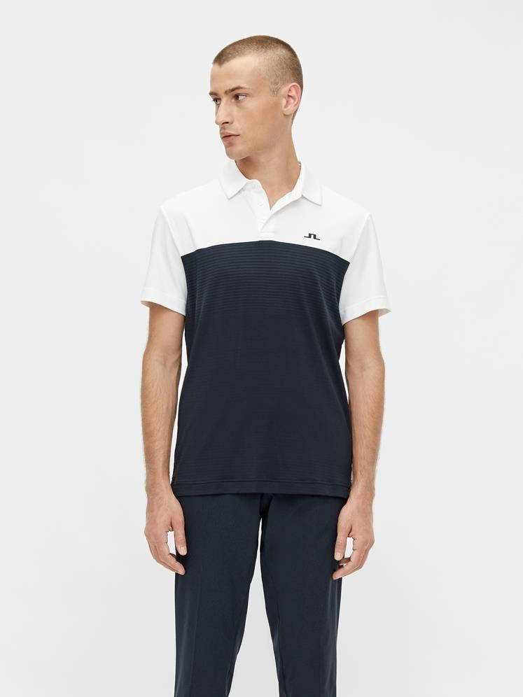 "<p><strong>Owen Slim Fit Golf Polo</strong></p><p>jlindebergusa.com</p><p><strong>$115.00</strong></p><p><a href=""https://www.jlindebergusa.com/shop/p/owen-slim-fit-golf-polo-23928?categoryid=766"" rel=""nofollow noopener"" target=""_blank"" data-ylk=""slk:Shop Now"" class=""link rapid-noclick-resp"">Shop Now</a></p><p>J.Lindberg also carries a ton of elevated golf apparel tailor-made for putting together a sharp look. The brand was early to the jogger game, but also carries traditional pants, polos and accessories. </p>"