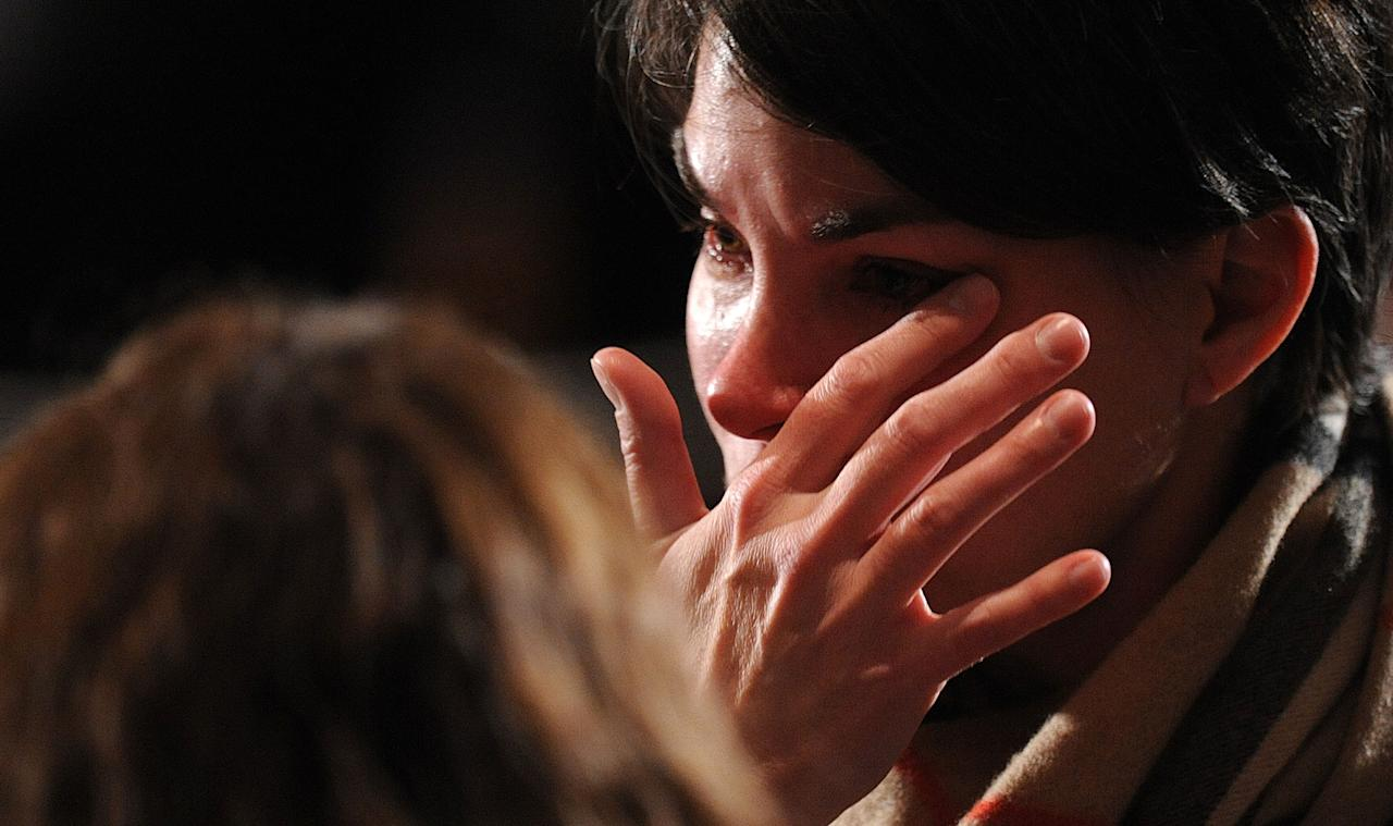 NEWTOWN, CT - DECEMBER 16:  A mourner cries before U.S. President Barack Obama speaks at an interfaith vigil for the shooting victims from Sandy Hook Elementary School on December 16, 2012 at Newtown High School in Newtown, Connecticut. Twenty-six people were shot dead, including twenty children, after a gunman identified as Adam Lanza opened fire at Sandy Hook Elementary School. Lanza also reportedly had committed suicide at the scene. A 28th person, believed to be Nancy Lanza, found dead in a house in town, was also believed to have been shot by Adam Lanza. (Photo by Olivier Douliery-Pool/Getty Images)