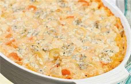 <p>We took the classic flavors of Buffalo wings--hot sauce, blue cheese, carrots and celery--and created a finger-licking-good casserole. Serve this dish during football season to a hungry crowd and it's sure to be a hit. We don't typically recommend ingredients by brand name, but in this case we make an exception for Frank's RedHot Sauce. It has the perfect balance of spice and tang for this casserole. Texas Pete and Crystal hot sauces are suitable alternatives if you can't find Frank's.</p>