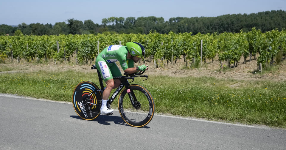 Britain's Mark Cavendish, wearing the best sprinter's green jersey, passes vineyards during the twentieth stage of the Tour de France cycling race, an individual time-trial over 30.8 kilometers (19.1 miles) with start in Libourne and finish in Saint-Emilion, France, Saturday, July 17, 2021. (AP Photo/Christophe Ena)