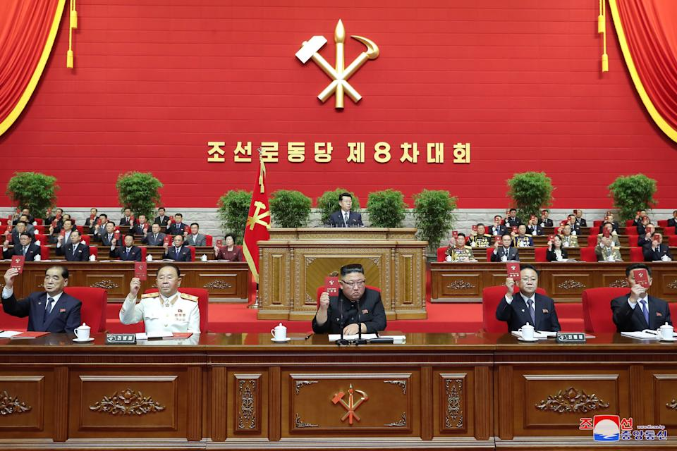 Leader of the Democratic People's Republic of Korea, Kim Jong-un, centre, speaks during the 8th Congress of the Workers' Part of Korea opening ceremony in Pyongyang. Source: EPA/KCNA