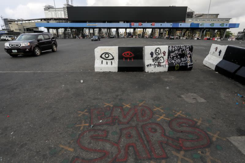 Words 'End Sars', referring to the Special Anti-Robbery Squad police unit, are written near the Lekki toll gate, in Lagos