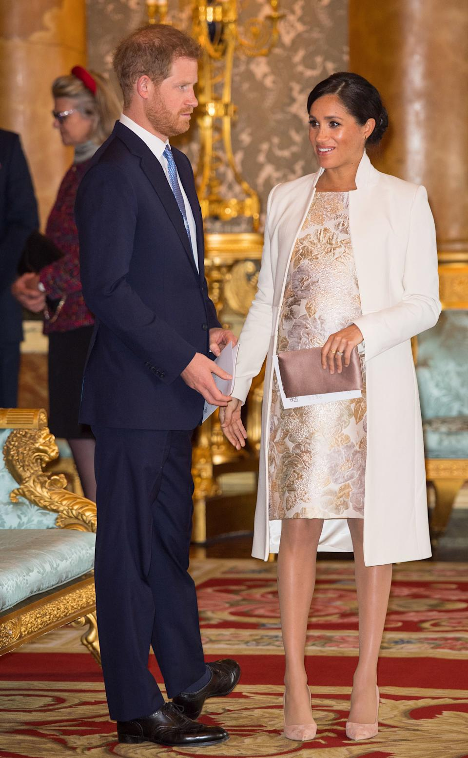 Wearing an Amanda Wakeley outfit and a clutch by Wilbur and Gussie. (Getty Images)