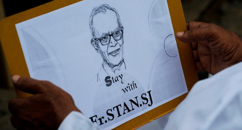 A priest holds a placard with the image of Jesuit priest Father Stan Swamy during a protest in Jharkhand in October 2020. Photo: Noah Seelam/AFP via Getty Images