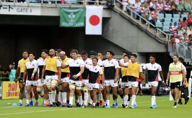 FILE - In this Sept. 28, 2019 file photo, the Japan team leave the field after a warm up ahead of the Rugby World Cup Pool A game at Shizuoka Stadium Ecopa against Ireland in Shizuoka, Japan. Japan will play South Africa in a quarterfinal in Tokyo on Sunday Oct. 20. (AP Photo/Eugene Hoshiko,File)
