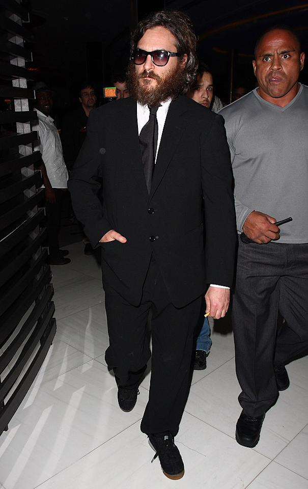 "Joaquin Phoenix confronted a heckler during his performance at LIV nightclub in Miami on Wednesday. Video of the actor-turned-rapper jumping into the crowd circulated the Internet the following day. John Parra/<a href=""http://www.wireimage.com"" target=""new"">WireImage.com</a> - March 11, 2009"