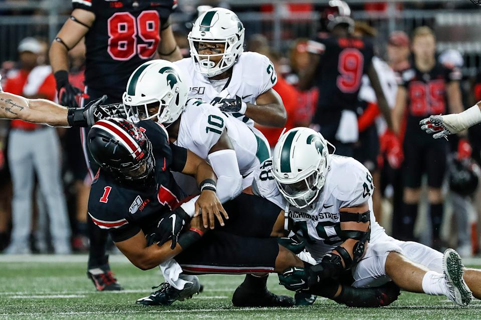 Michigan State safety Michael Dowell (10) and defensive end Kenny Willekes (48) sack Ohio State quarterback Justin Fields during the first quarter at Ohio Stadium in Columbus, Ohio, Saturday, Oct. 5, 2019.