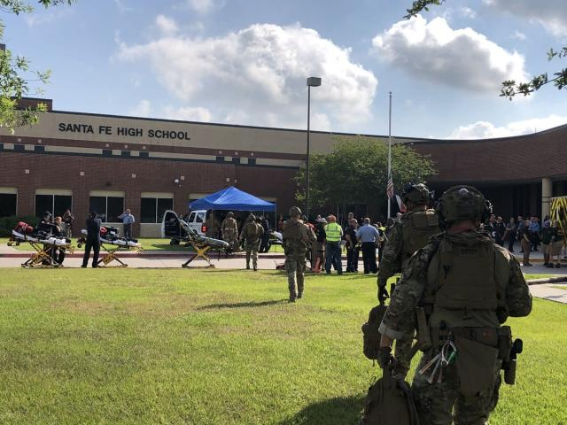 <p>Harris County police assist at the scene after a multiple-casualty shooting at Santa Fe High School in Santa Fe, Texas, May 18, 2018. (Photo: HCSOTexas via Twitter) </p>