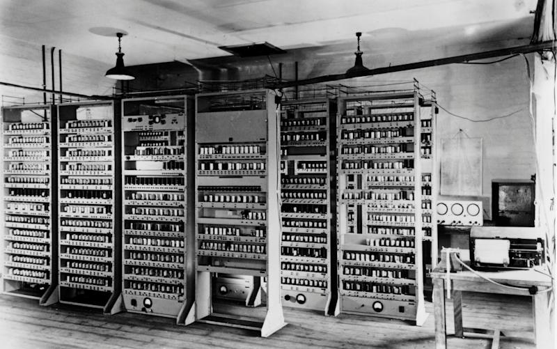 Racks of vacuum tubes and diodes sit in rows of cabinets as part of the ENIAC computer built for the United States Military in 1946 - Credit: SSPL/Getty