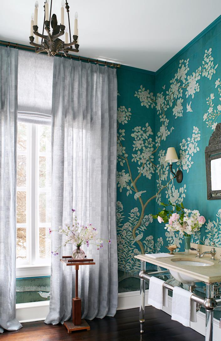 In a powder room, Roman shades in Breeze and drapery in Oceana.