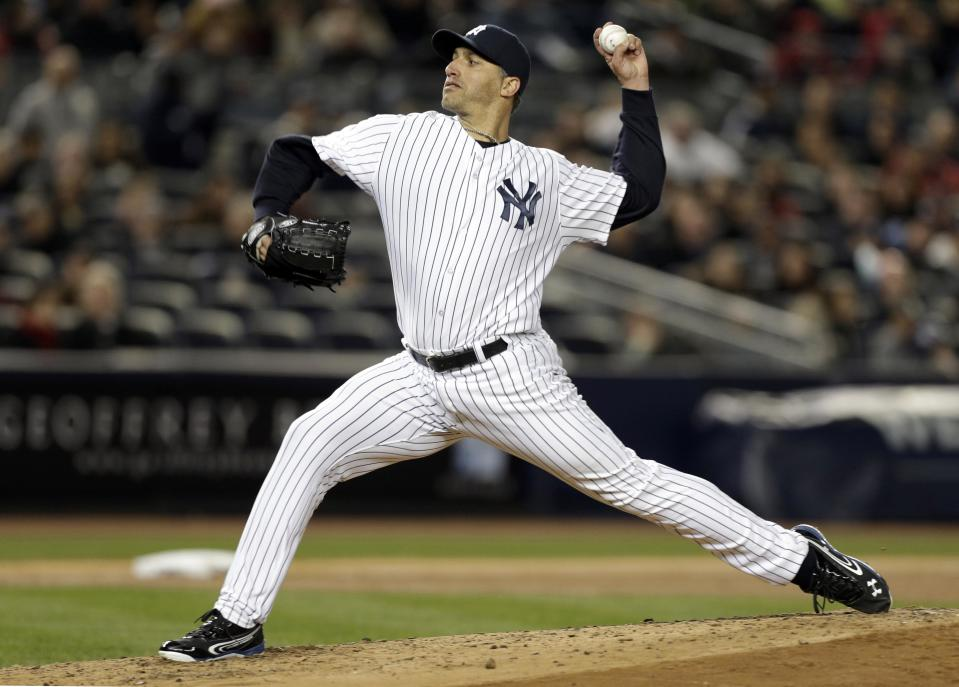 New York Yankees starting pitcher Andy Pettitte delivers in the fifth inning against the Boston Red Sox in a baseball game at Yankee Stadium in New York, Thursday, April 4, 2013. (AP Photo/Kathy Willens)