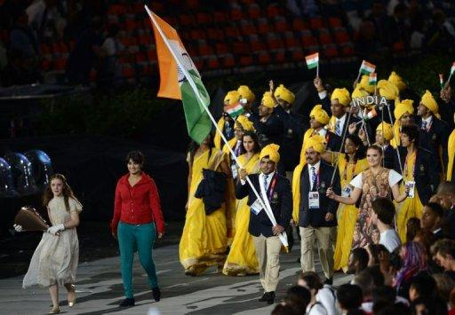 Madhura Nagendra (2L) gatecrashes the procession of India's athletes at the opening of the London Olympic Games