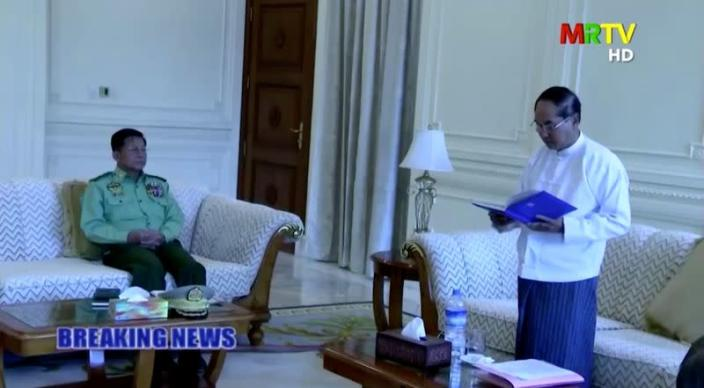 A screen grab from Myanmar state television footage, broadcast on February 1, 2021, shows Myanmar Acting President Myint Swe (R) reading a statement, as General Min Aung Hlaing (L) looks on