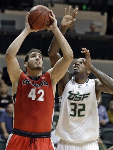 Georgia forward Nemanja Djurisic (42) goes up for a shot in front of South Florida forward Toarlyn Fitzpatrick (32) during the first half of an NCAA college basketball game Friday, Nov. 30, 2012, in Tampa, Fla. (AP Photo/Chris O'Meara)