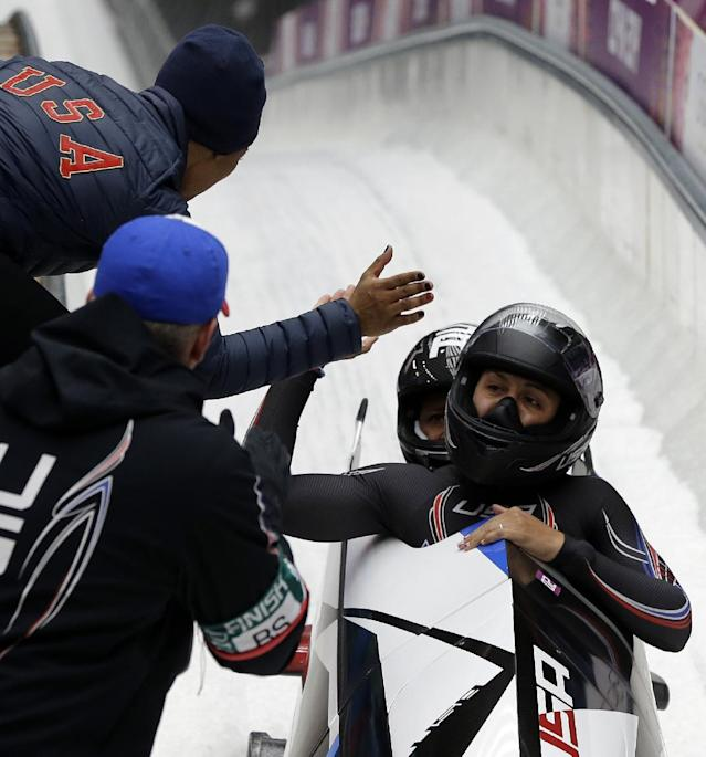 The team from the United States USA-1, piloted by Elana Meyers with brakeman Lauryn Williams, cross into the finish area to win the silver medal during the women's bobsled competition at the 2014 Winter Olympics, Wednesday, Feb. 19, 2014, in Krasnaya Polyana, Russia. (AP Photo/Michael Sohn)