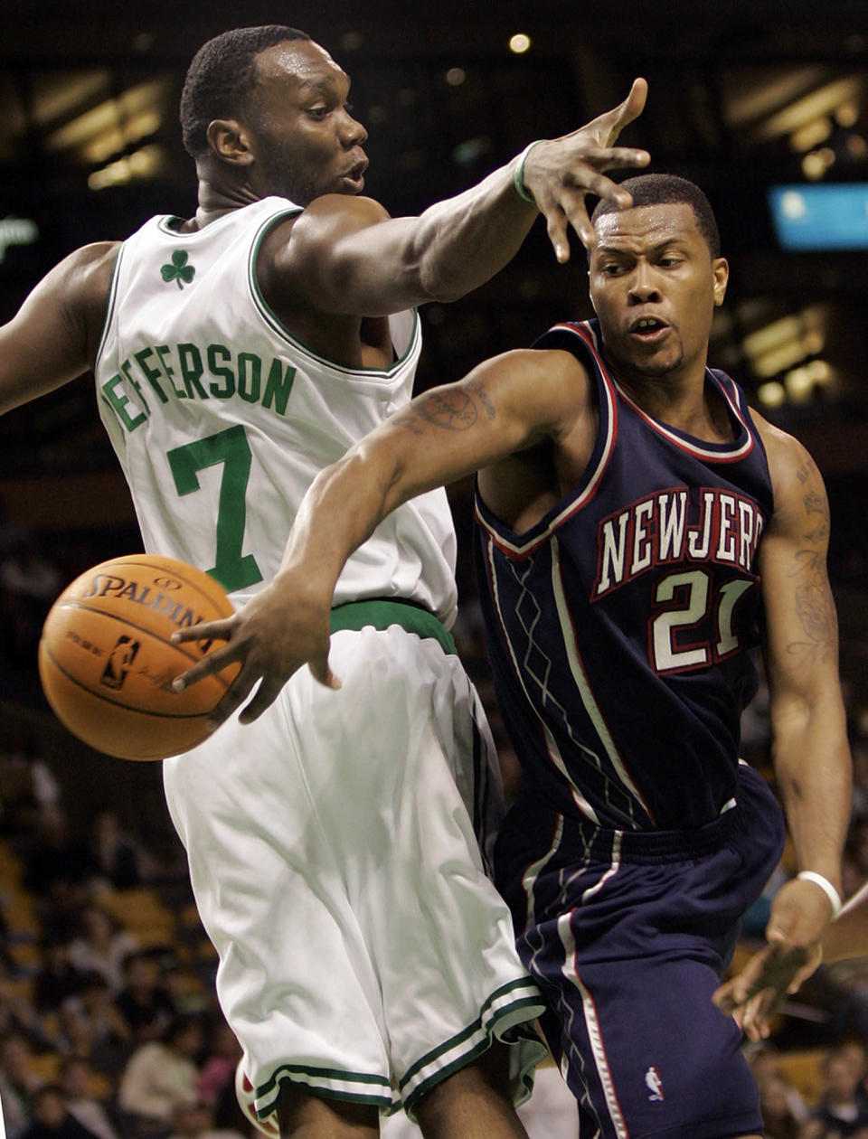 FILE - Boston Celtics' Al Jefferson (7) tries to stop New Jersey Nets' Antoine Wright (21) during the first quarter of an NBA basketball game in Boston, in this Wednesday, Oct. 18, 2006, file photo. Eighteen former NBA players, including Wright, have been indicted on charges alleging they defrauded the league's health and welfare benefit plan out of about $4 million, according to an indictment Thursday. (AP Photo/Chitose Suzuki, File)