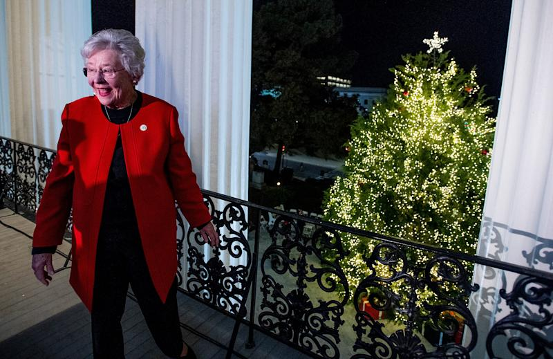 Alabama Gov. Kay Ivey checks out the State Capitol Christmas tree during the 2018 tree-lighting ceremony in Montgomery.