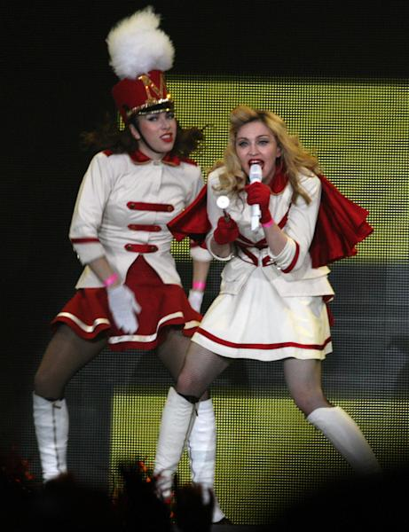U.S. singer Madonna, right, performs during her concert at concert Hall in St. Petersburg, Russia, Thursday, Aug. 9, 2012. (AP Photo/ Olga Maltseva, Pool)