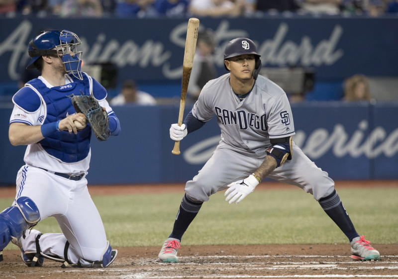 San Diego Padres' Manny Machado takes a called strike as Toronto Blue Jays catcher Danny Jansen hangs onto the ball in the fourth inning of their baseball game in Toronto, Sunday, May 26, 2019. (Fred Thornhill/The Canadian Press via AP)