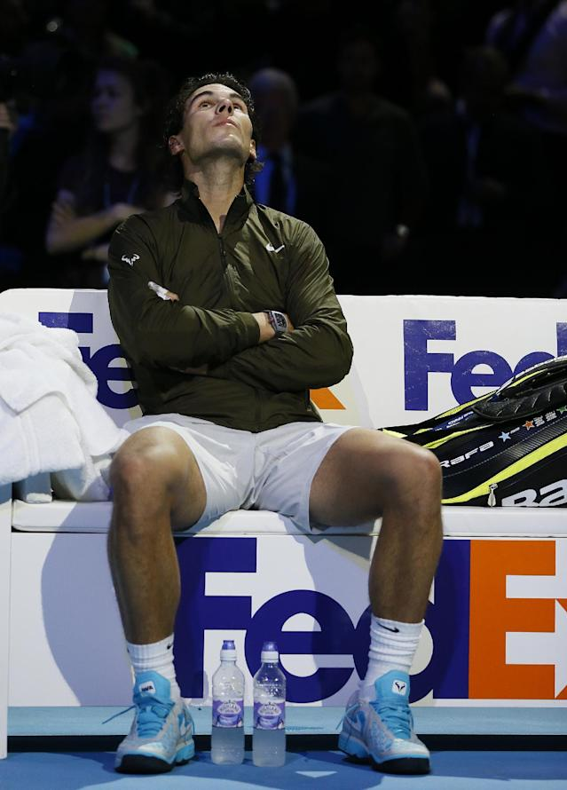 Rafael Nadal of Spain sists in his chair as he waits for the presentation ceremony to begin after he lost to Novak Djokovic of Serbia during the final of the ATP World Tour Finals at the O2 Arena in London, Monday, Nov. 11, 2013. (AP Photo/Kirsty Wigglesworth)