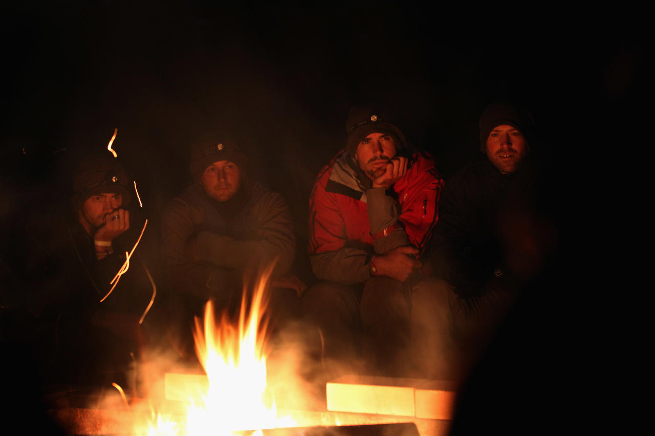 NUREMBERG, GERMANY - SEPTEMBER 26:  England players from left James Anderson, Tim Bresnan, Kevin Pietersen and Matt Prior listen in  round the camp fire at the England Cricket squad Pre Ashes Training Camp on September 26, 2010 near Nuremberg, Germany.  (Photo by Stu Forster/Getty Images)