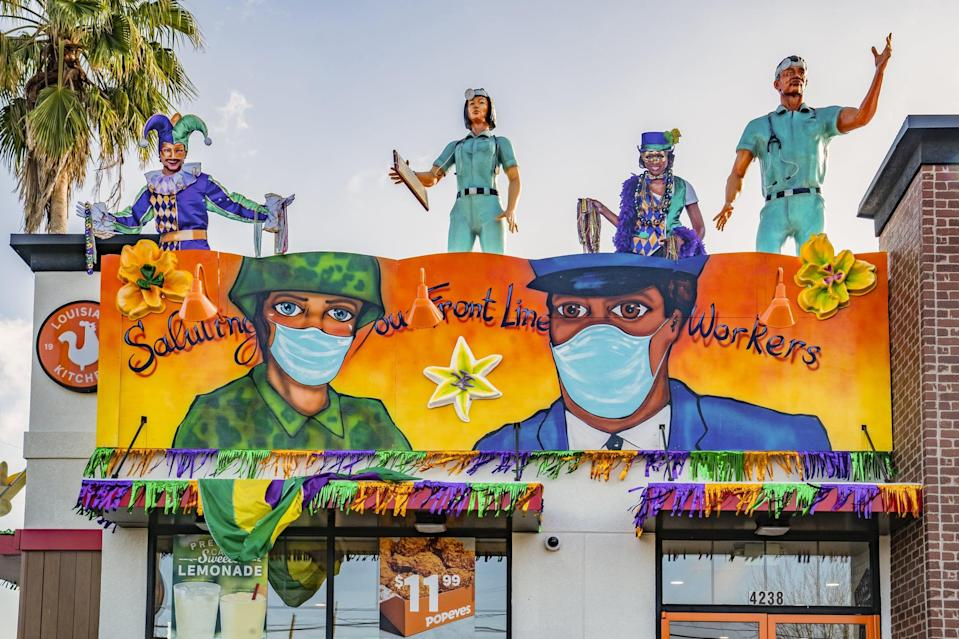 <p>A nod to all front-line workers who've been protecting us during the pandemic, a New Orleans Popeyes decorated their storefront with a banner recognizing nurses, doctors, police officers, and the armed forces. The store also added life-size statues of workers on the rooftop saluting those who pass by.</p>