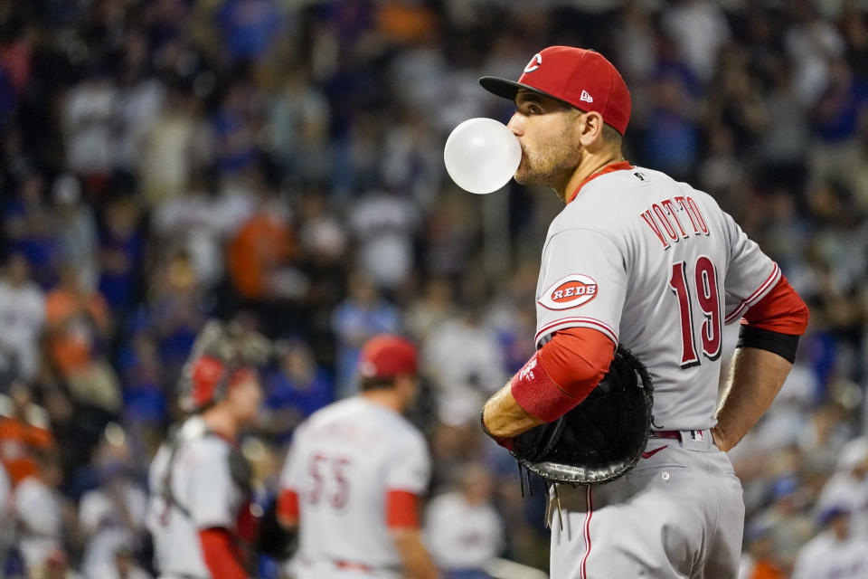 Cincinnati Reds' Joey Votto blows a gum bubble in the ninth inning of the baseball game against the New York Mets, Saturday, July 31, 2021, in New York. (AP Photo/Mary Altaffer)