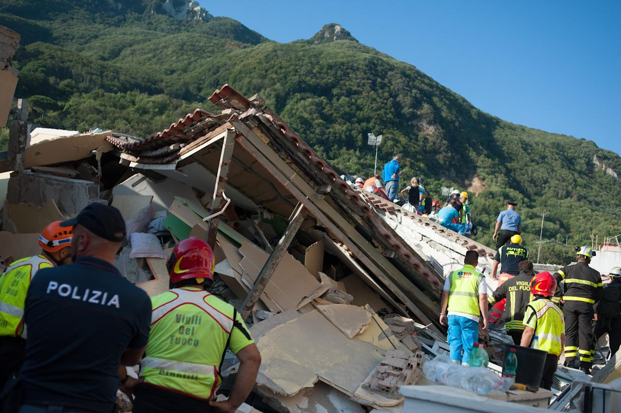 <p>Rescuers dig through the rubble during a search for two missing children on Aug. 22, 2017 in Casamicciola Terme, Italy. (Photo: Ivan Romano/Getty Images) </p>