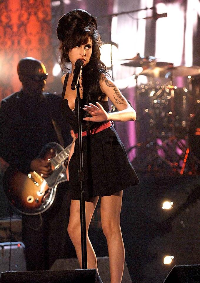 """Amy Winehouse performs """"Rehab"""" at the 2007 MTV Movie Awards. Kevin Mazur/<a href=""""http://www.wireimage.com"""" target=""""new"""">WireImage.com</a> - June 3, 2007"""