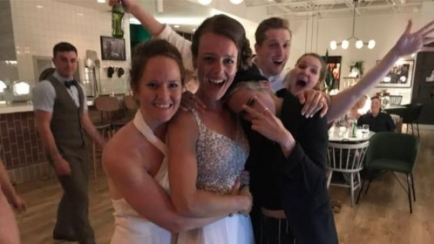 Kirsten (centre) and Kayleigh (left) Jennings were surprised by Hollywood star Kristen Stewart (right) at their wedding on Saturday in Winnipeg. (Instagram )