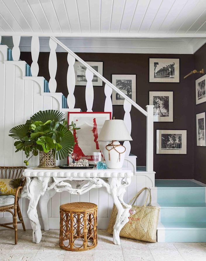 """<p>For <a href=""""https://www.veranda.com/decorating-ideas/house-tours/a32721431/matthew-carter-harbour-island-cottage/"""" rel=""""nofollow noopener"""" target=""""_blank"""" data-ylk=""""slk:his Harbour Island cottage"""" class=""""link rapid-noclick-resp"""">his Harbour Island cottage</a>, designer Matthew Carter took palette inspiration from """"a few simple colors,"""" including """"dark brown and a whole lot of white. This combination feels elegantly organic to me.""""</p><p><a class=""""link rapid-noclick-resp"""" href=""""https://www.benjaminmoore.com/en-us/color-overview/find-your-color/color/2115-10/appalachian-brown?color=2115-10"""" rel=""""nofollow noopener"""" target=""""_blank"""" data-ylk=""""slk:Get the Look"""">Get the Look</a></p>"""