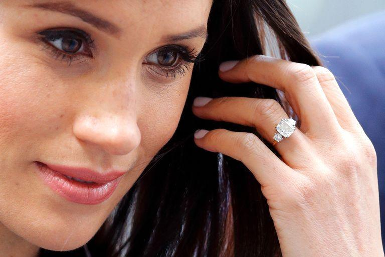<p>Prince Harry chose a Botswana diamond flanked by two smaller diamonds from Princess Diana's private collection when he proposed to Meghan Markle in 2017. The three-stone ring created a new interest in the style, which hasn't been popular since the '80s. </p>