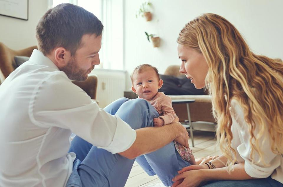 Parents and Crying Baby At Home