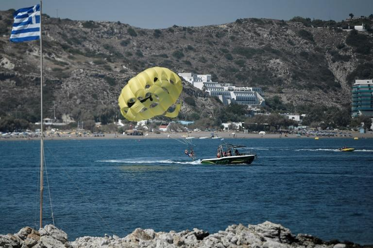 Parasailing, seen here in a file picture taken in August this year, is a popular pursuit among British tourists on the island of Rhodes.