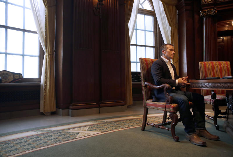 Missouri Gov. Eric Greitens pauses during an interview in his office at the Missouri Capitol Saturday, Jan. 20, 2018, in Jefferson City, Mo. Greitens discussed having an extramarital affair in 2015 before taking office. (AP Photo/Jeff Roberson)