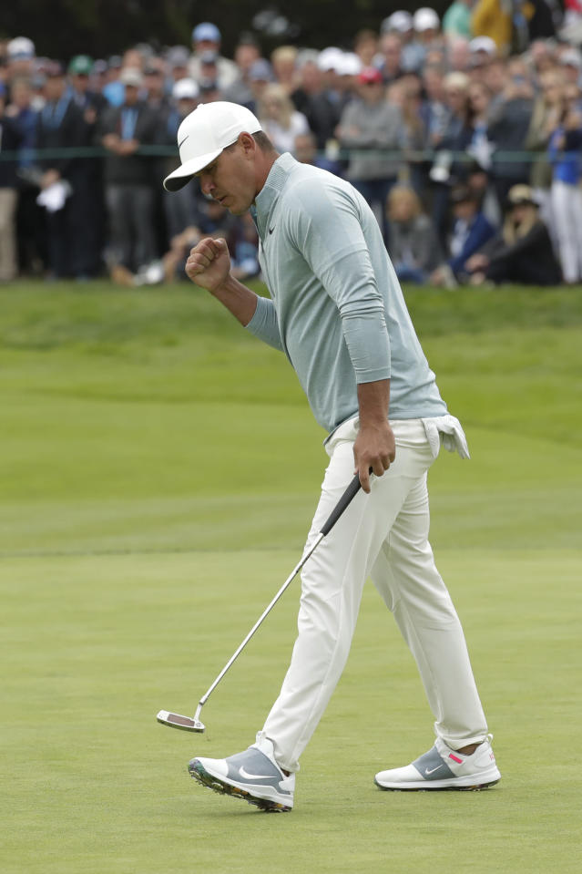Brooks Koepka reacts after making a putt on the 11th hole during the final round of the U.S. Open Championship golf tournament Sunday, June 16, 2019, in Pebble Beach, Calif. (AP Photo/Matt York)