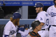 Los Angeles Dodgers' Max Muncy, right, is congratulated by Justin Turner after hitting a solo home run during the sixth inning of a baseball game Friday, July 24, 2020, in Los Angeles. (AP Photo/Mark J. Terrill)