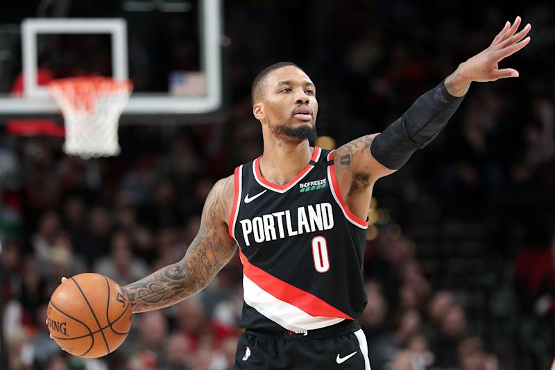 Damian Lillard #0 of the Portland Trail Blazers points down the court against the Golden State Warriors in the first quarter during their game at Moda Center on January 20, 2020 in Portland, Oregon. NOTE TO USER: User expressly acknowledges and agrees that, by downloading and or using this photograph, User is consenting to the terms and conditions of the Getty Images License Agreement (Photo by Abbie Parr/Getty Images) (Photo by Abbie Parr/Getty Images)
