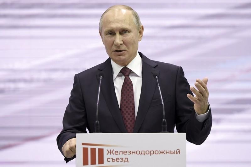 FILE PHOTO: Russian President Putin delivers a speech at the Railway Congress in Moscow