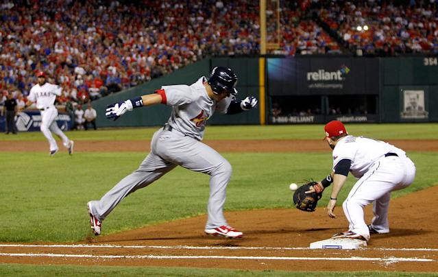 ARLINGTON, TX - OCTOBER 23: Jon Jay #19 of the St. Louis Cardinals is thrown out at first base by Elvis Andrus #1 of the Texas Rangers in the third inning during Game Four of the MLB World Series at Rangers Ballpark in Arlington on October 23, 2011 in Arlington, Texas. (Photo by Tom Pennington/Getty Images)