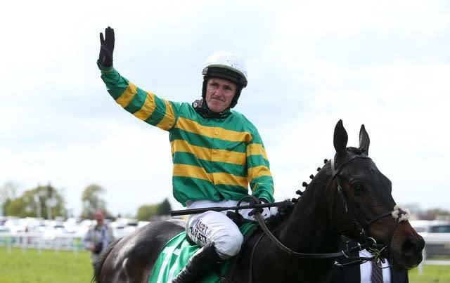 Sir Anthony McCoy waves to the crowd following his last ever ride (David Davies/PA)