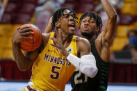 Minnesota guard Marcus Carr (5) drives to the basket past North Dakota guard Ethan Igbanugo (21) during the first half of an NCAA college basketball game Friday, Dec. 4, 2020, in Minneapolis. (AP Photo/Bruce Kluckhohn)