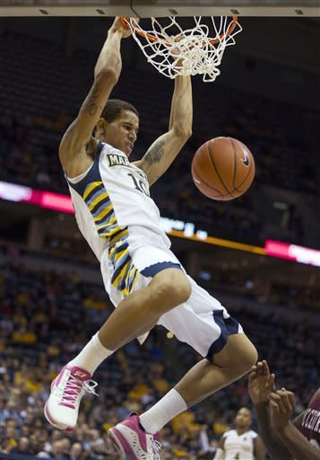 Marquette's Juan Anderson dunks the ball against North Carolina Central during the first half of an NCAA college basketball game Saturday, Dec. 29, 2012, in Milwaukee. (AP Photo/Tom Lynn)