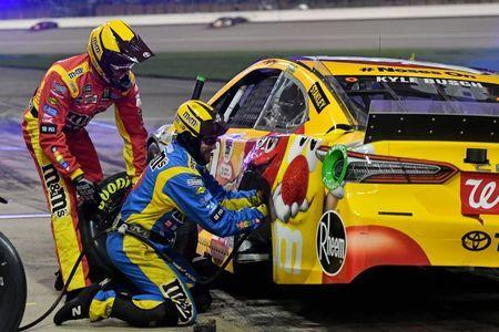 May 11, 2019; Kansas City, KS, USA; Crew members work on the car of NASCAR Cup Series driver Kyle Busch (18) during the Digital Ally 400 at Kansas Speedway. Mandatory Credit: Jasen Vinlove-USA TODAY Sports