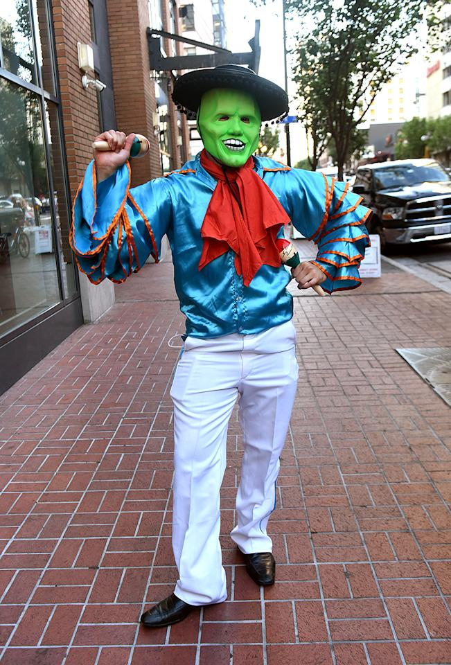 <p>Cosplayer dressed as <i>The Mask</i> at Comic-Con International on July 21, 2018, in San Diego. (Photo: Vivien Killilea/Getty Images) </p>