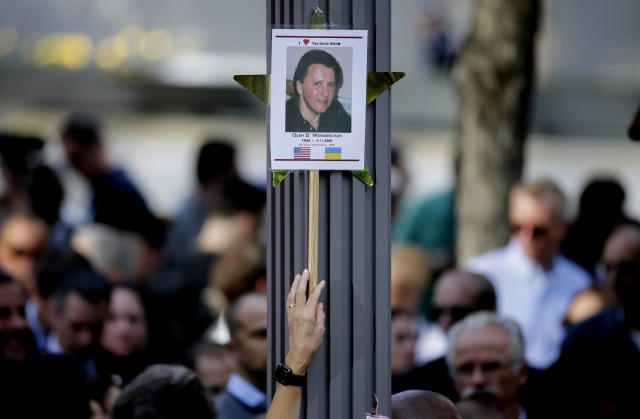 <p>A woman holds up a picture of a victim of the 9/11 terrorist attacks during a ceremony at ground zero in New York, Monday, Sept. 11, 2017. Holding photos and reading names of loved ones lost 16 years ago, 9/11 victims' relatives marked the anniversary of the attacks at ground zero with a solemn and personal ceremony. (Photo: Seth Wenig/AP) </p>