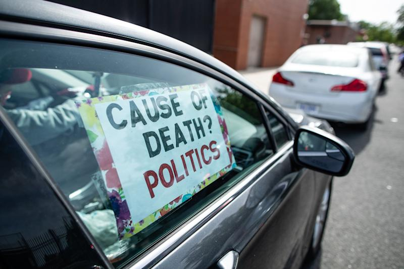 """""""Tens of thousands of those deaths are due to the inaction and chaotic leadership of the Trump Administration and Republican elected officials across the country,"""" the progressive groups organizing the """"Day of Mourning"""" said in a statement. (Yilmaz Akin/Subminimal for Care in Action)"""