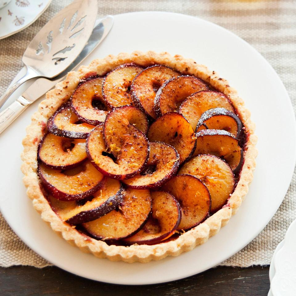"""Brandy, cinnamon, and lemon zest combine to give this tart unbelievable aroma and wonderful flavor. <a href=""""https://www.epicurious.com/recipes/food/views/italian-plum-tart-em-tarte-aux-quetsches-em-360490?mbid=synd_yahoo_rss"""" rel=""""nofollow noopener"""" target=""""_blank"""" data-ylk=""""slk:See recipe."""" class=""""link rapid-noclick-resp"""">See recipe.</a>"""