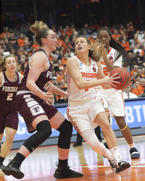 Syracuse's Tiana Mangakahia, pushes past Fordham's Kaitlyn Downey enroute to the basket during of a first-round game in the NCAA womens college basketball tournament in Syracuse, N.Y., Saturday, March 23, 2019. (AP Photo/Heather Ainsworth)